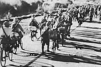 Bicyclemounted_japanese_troops_in_t